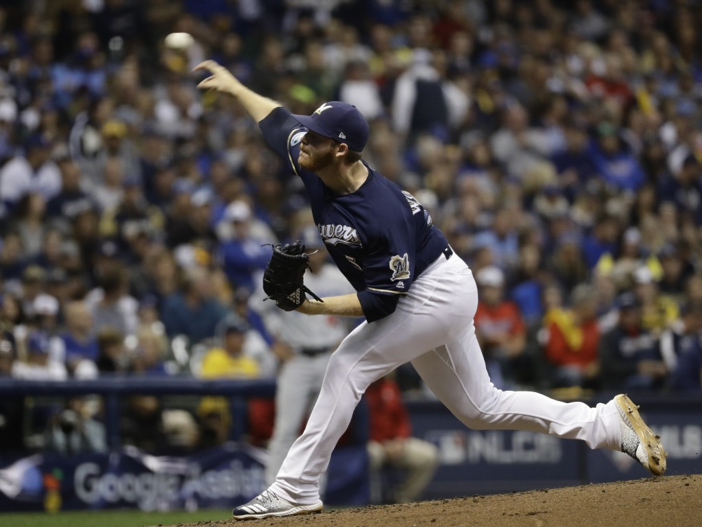 Milwaukee Brewers relief pitcher Brandon Woodruff throws during the third inning of Game 1 of the National League Championship Series baseball game ag