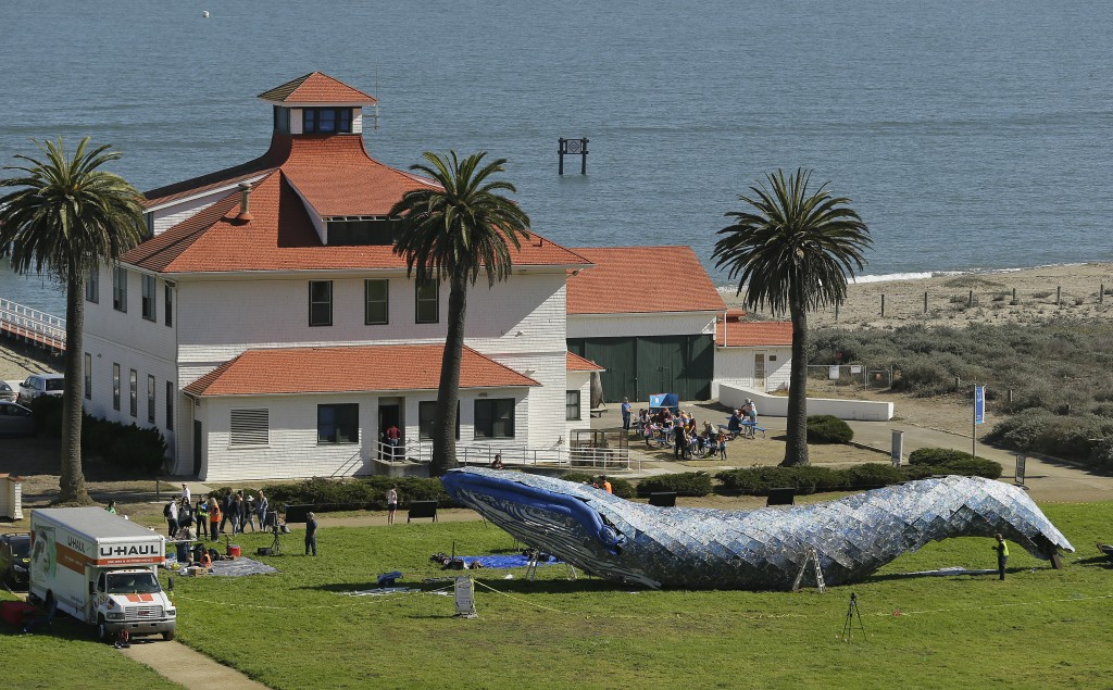 Artist Joel Deal Stockdill, lower right, works on a blue whale art piece made from discarded single-use plastic at Crissy Field Friday, Oct. 12, 2018,