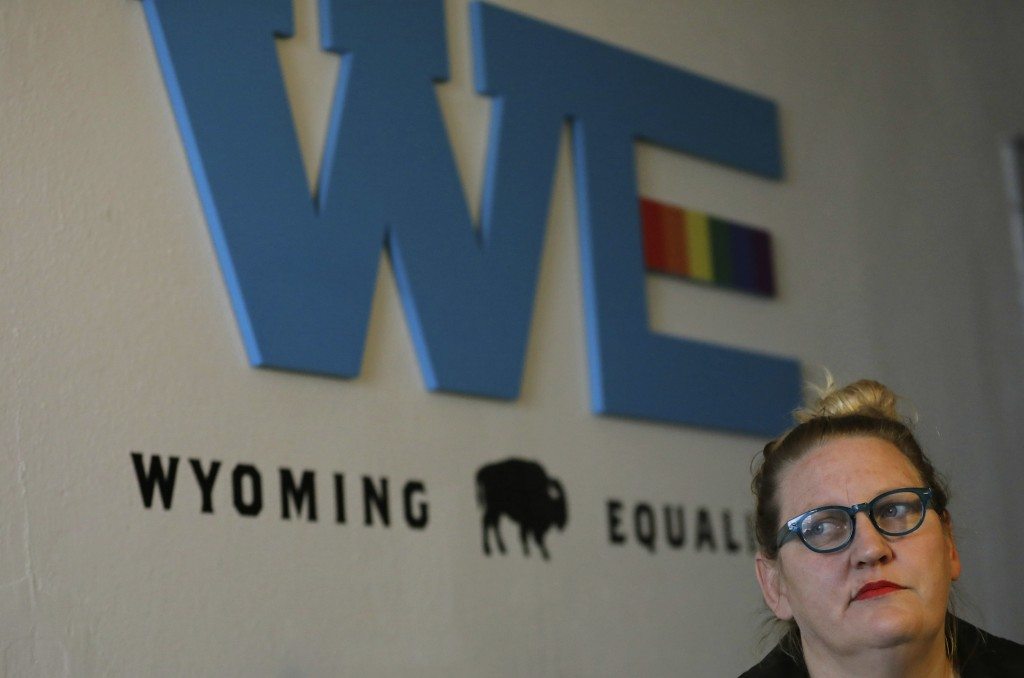 In this Tuesday, Oct. 9, 2018 photo, Sara Burlingame, executive director of the Cheyenne-based LGBTQ advocacy group Wyoming Equality, speaks during an