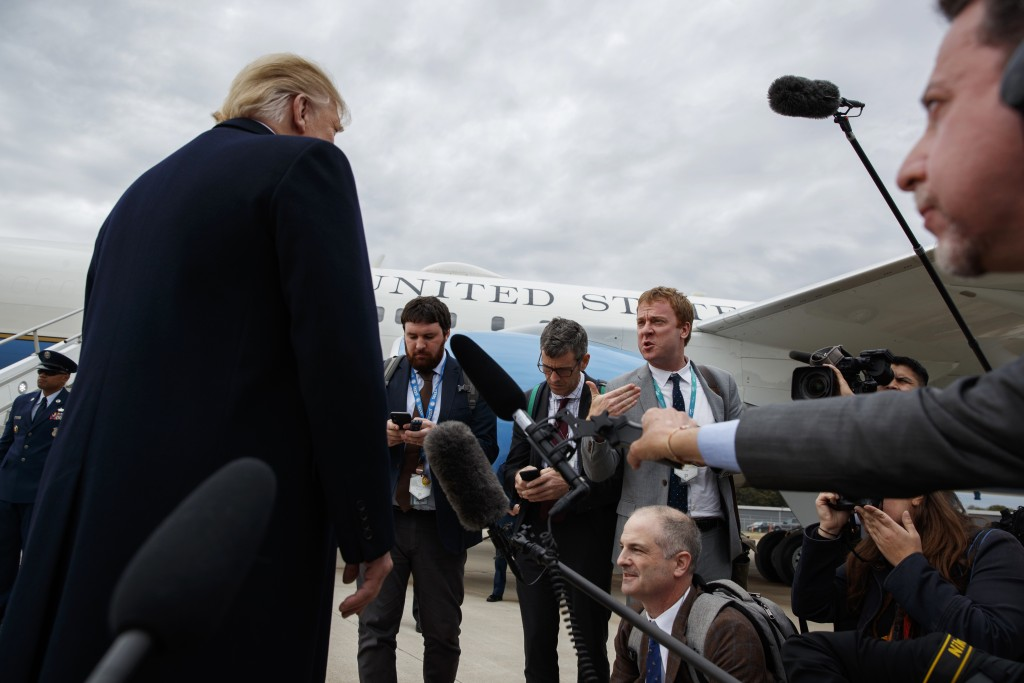 President Donald Trump listens to a question about the missing Saudi journalist Jamal Khashoggi after landing at Cincinnati Municipal Lunken Airport,