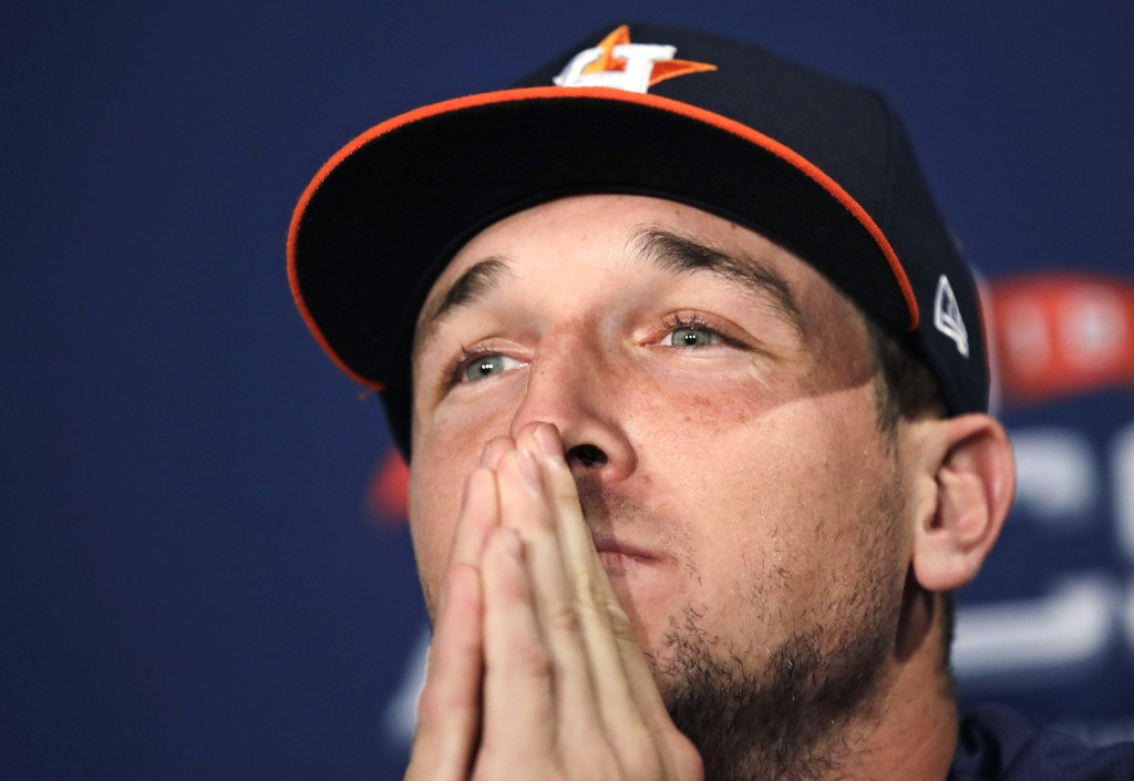 Houston Astros third baseman Alex Bregman listens to a reporter's question during a news conference prior to a workout at Fenway Park, Friday, Oct. 12