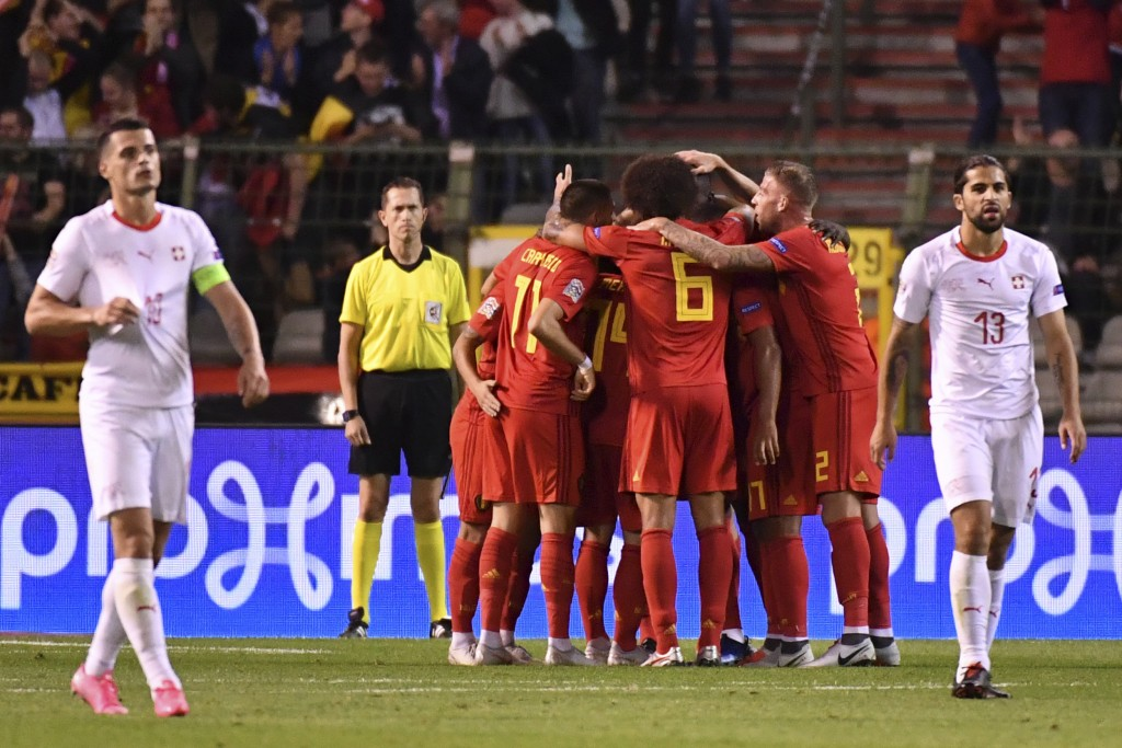 Belgium players celebrate after teammate Romelu Lukaku scored their side's first goal during the UEFA Nations League soccer match between Belgium and