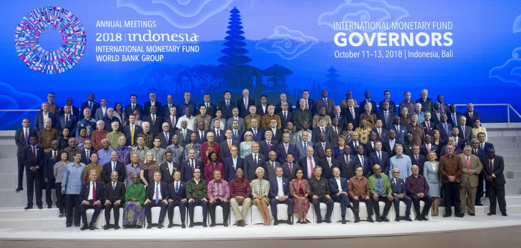 International Monetary Fund (IMF) governors gather for a group photo during the IMF and World Bank meetings in Bali, Indonesia on Saturday, Oct. 13, 2