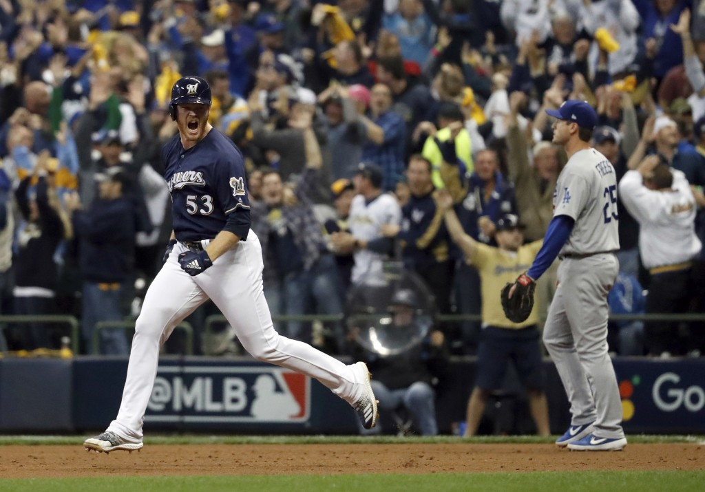 Milwaukee Brewers' Brandon Woodruff (53) celebrates after hitting a home run during the third inning of Game 1 of the National League Championship Ser