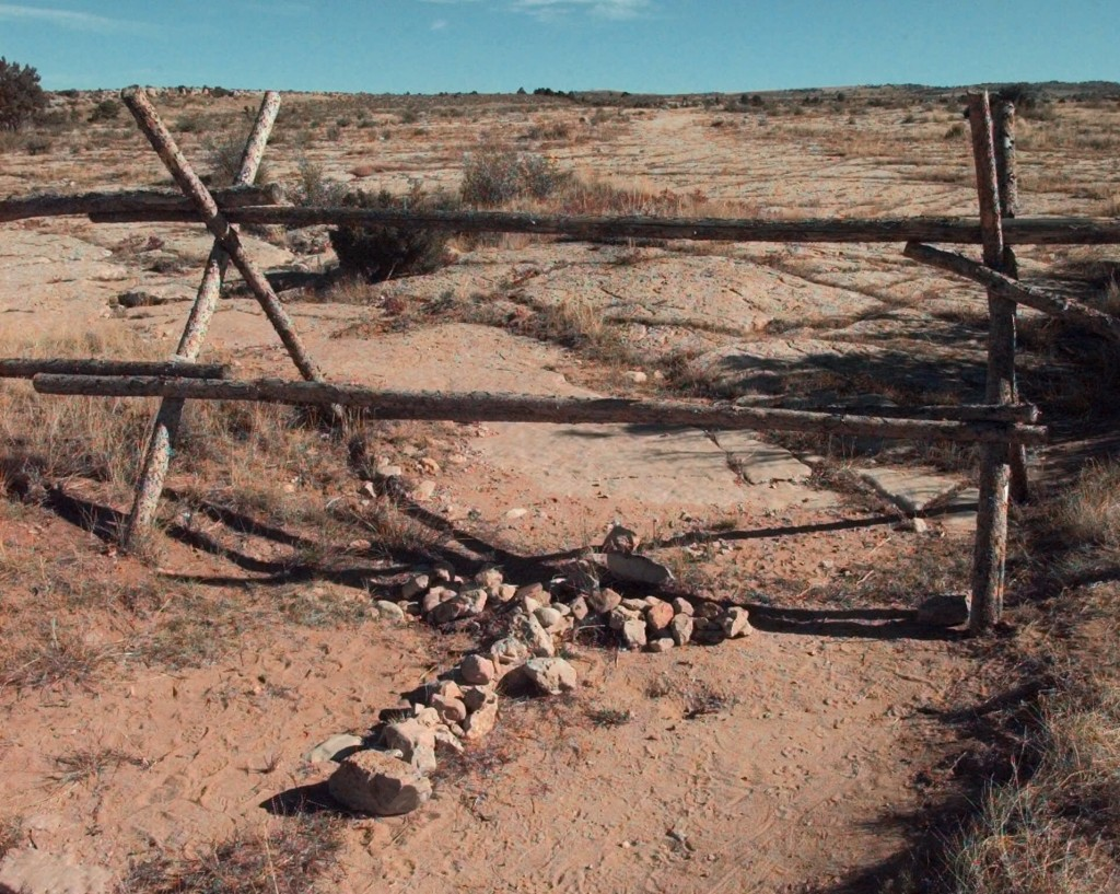 FILE - In this Oct. 9, 1999 file photo, a cross made of stones rests below the fence in Laramie, Wyo. where a year earlier, University of Wyoming stud