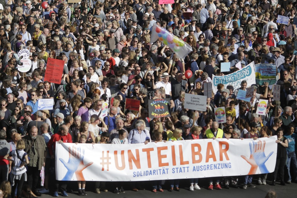 Thousands of people attend a demonstration with the slogan 'indivisible' against hate and four solidarity instead of exclusion in Berlin, Germany, Sat