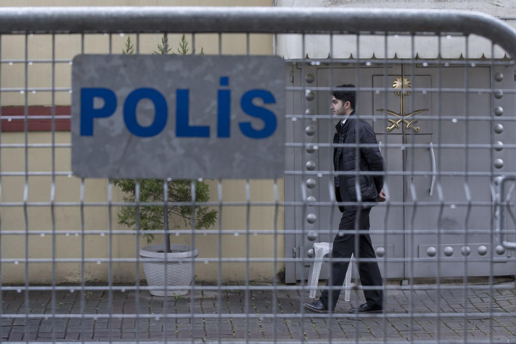 A security personnel walks past the entrance of Saudi Arabia's consulate in Istanbul, Saturday, Oct. 13, 2018. Turkish officials have an audio recordi
