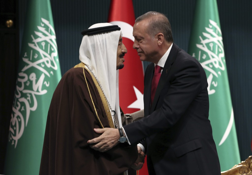 FILE - In this April 12, 2016 photograph, Turkish President Recep Tayyip Erdogan, right, and Saudi Arabia's King Salman embrace each other during a me
