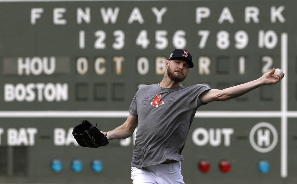 Boston Red Sox pitcher Chris Sale throws during a baseball workout at Fenway Park, Friday, Oct. 12, 2018, in Boston. Sale is scheduled to start agains