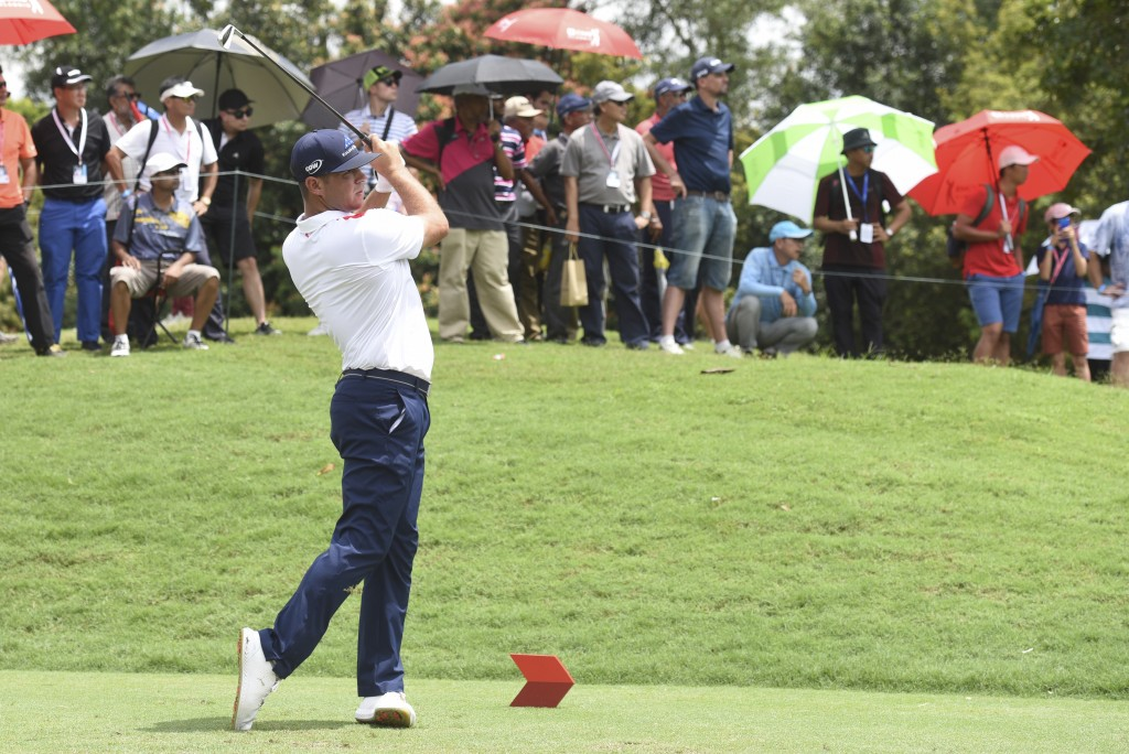 Gary Woodland of the United States follows his shot on the ninth hole during third round of the CIMB Classic golf tournament at Tournament Players Clu