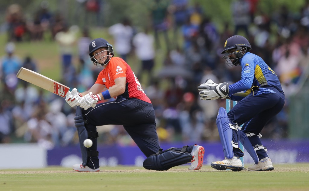 England's Joe Root plays a shot as Sri Lanka's wicketkeeper Niroshan Dickwella watches during their second one-day international cricket match in Damb