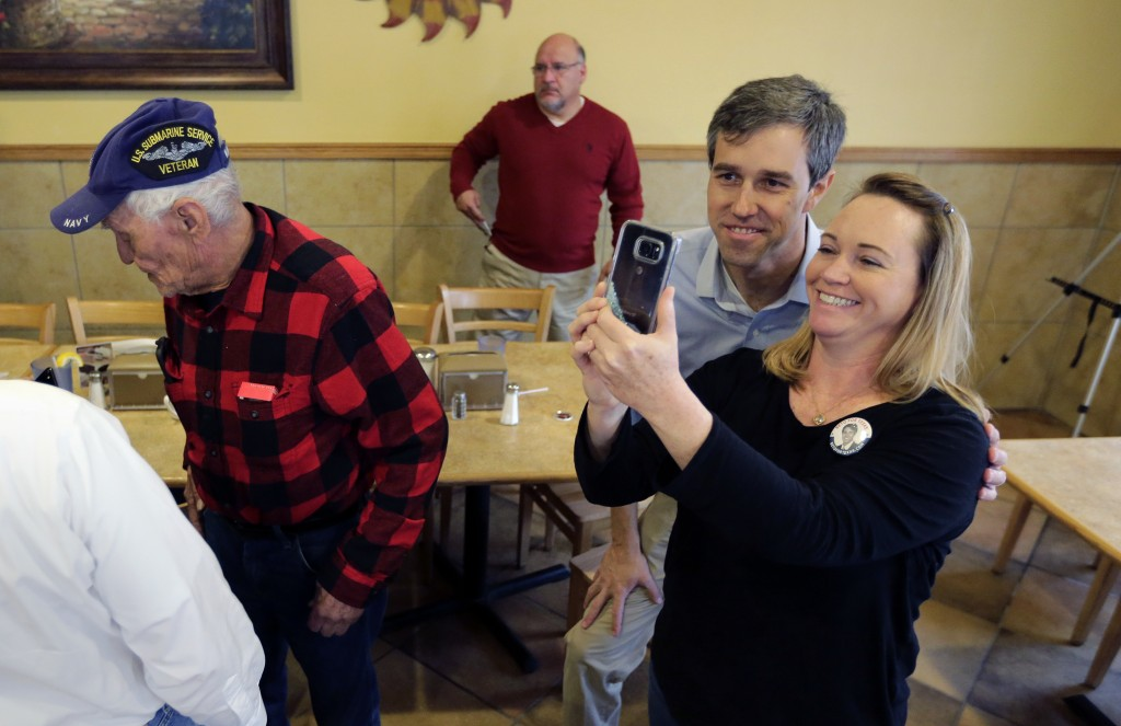 FILE - In this Sunday, Jan. 7, 2018, file photo, Texas Democratic Congressman Beto O'Rourke, second from right, poses for a photo following a town hal