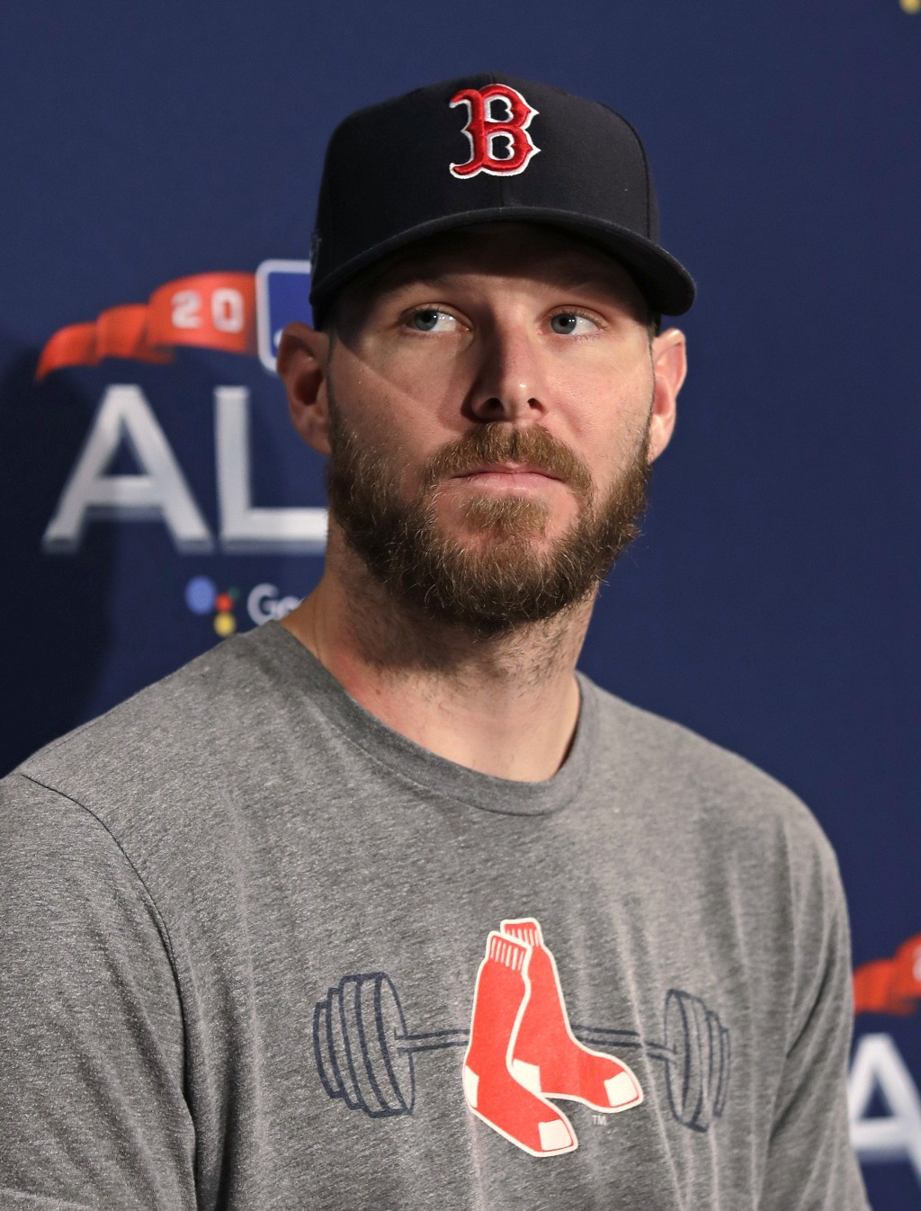 Boston Red Sox starting pitcher Chris Sale listens to a question during a news conference prior to a workout at Fenway Park, Friday, Oct. 12, 2018, in