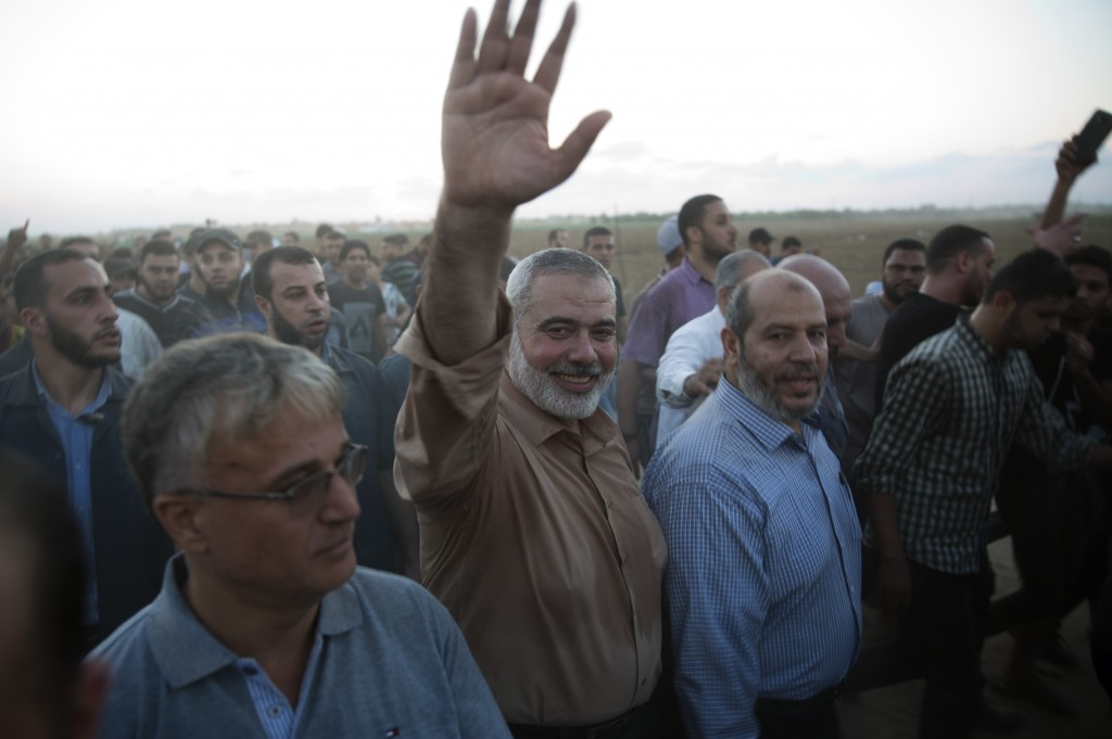 Palestinian Hamas top leader Ismail Haniyeh, waves to protesters during a protest at the Gaza Strip's border with Israel, Friday, Oct. 12, 2018. (AP P