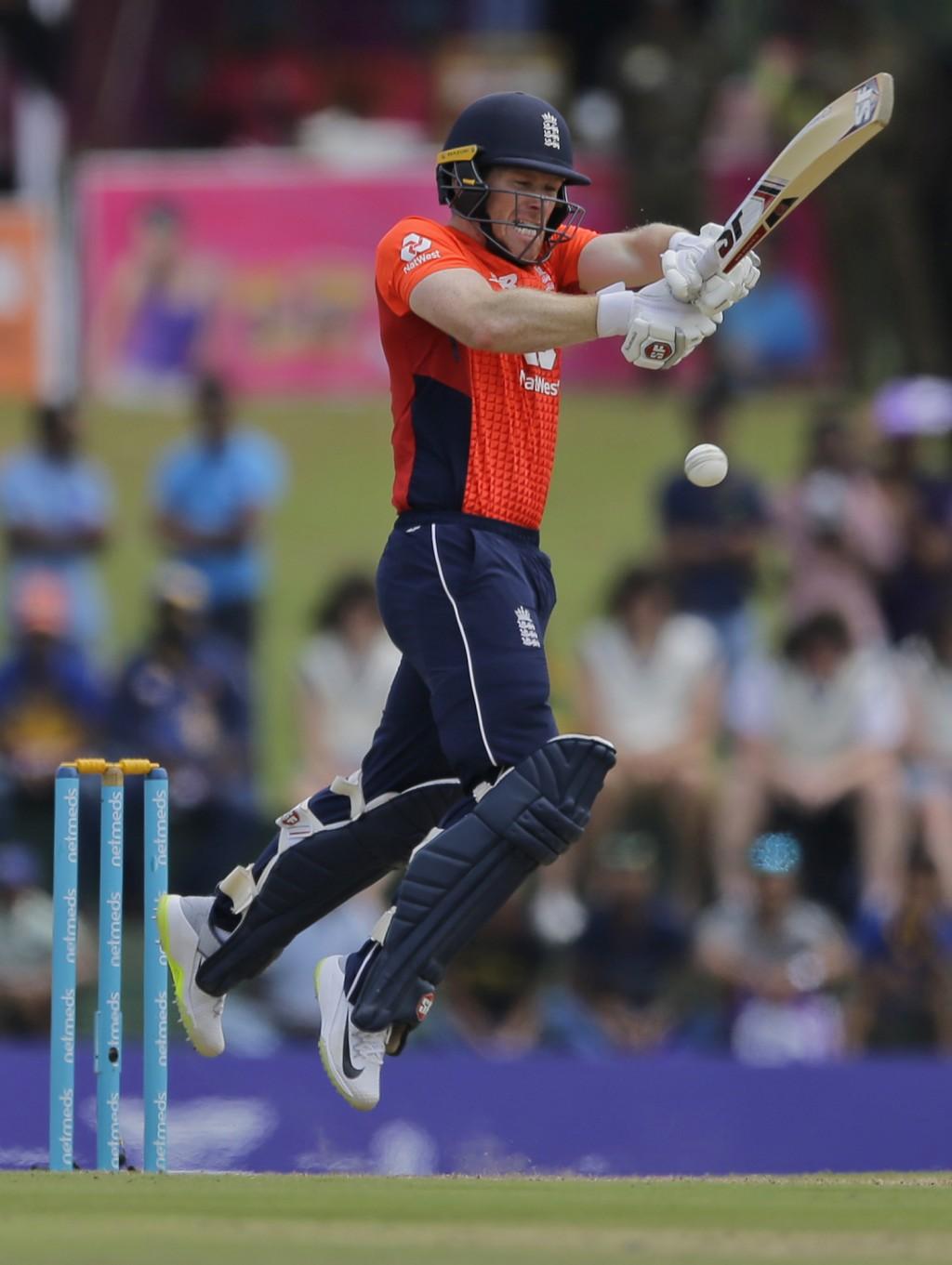 England's Eoin Morgan plays a shot during their second one-day international cricket match with Sri Lanka in Dambulla, Sri Lanka, Saturday, Oct. 13, 2