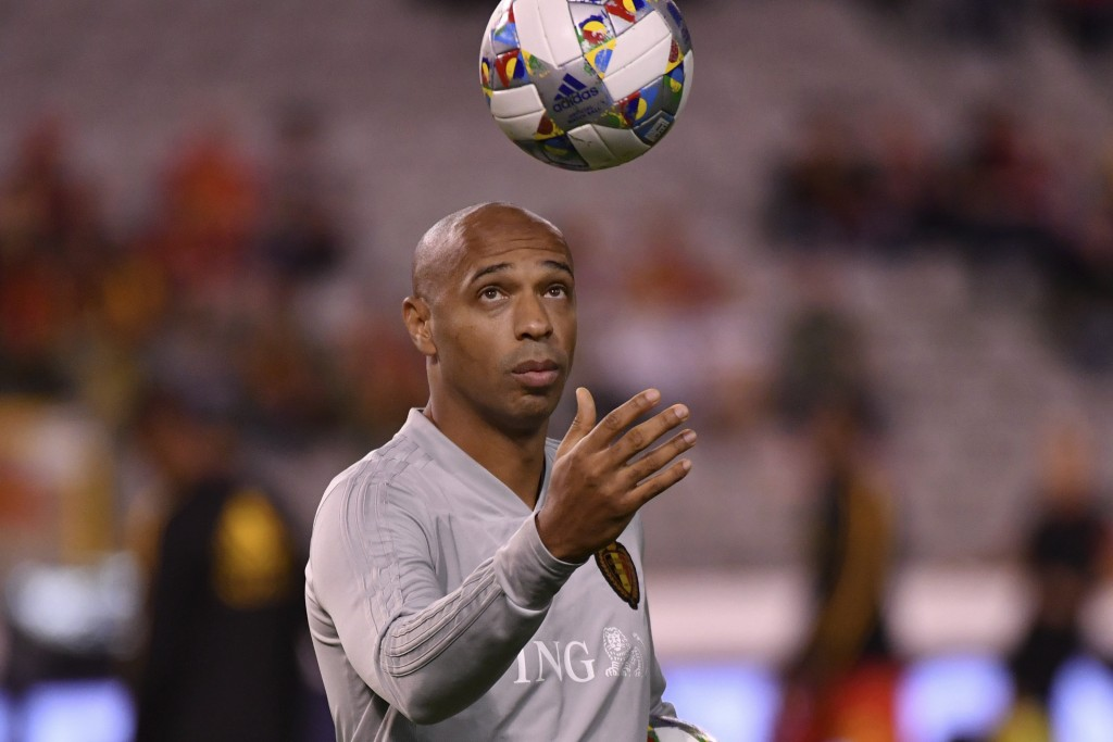Belgium assistant coach Thierry Henry plays with a ball prior the UEFA Nations League soccer match between Belgium and Switzerland at the King Baudoui