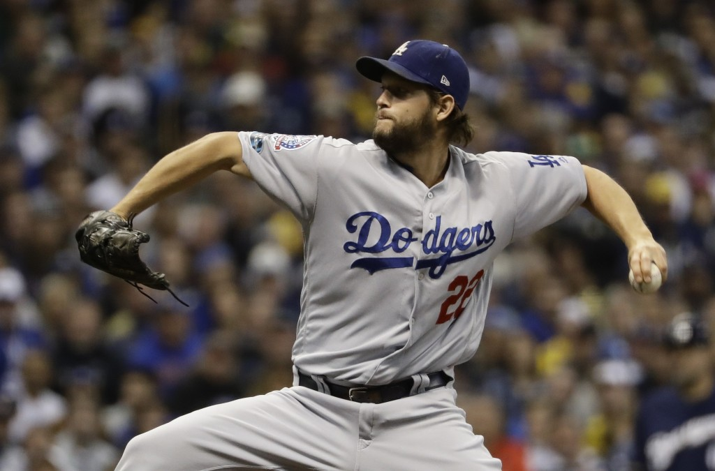 Los Angeles Dodgers' Clayton Kershaw throws during the first inning of Game 1 of the National League Championship Series baseball game against the Mil