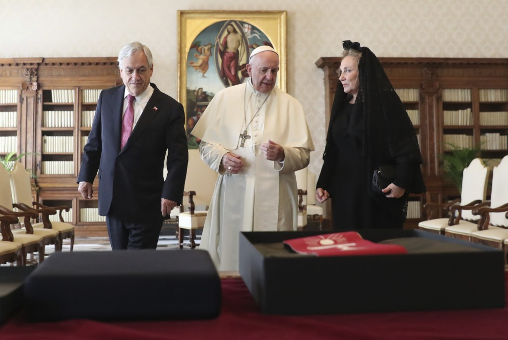 Pope Francis speaks as he meets with Chile's President Sebastian Pinera and his wife Cecilia Morel during a private audience at the Vatican, Saturday,