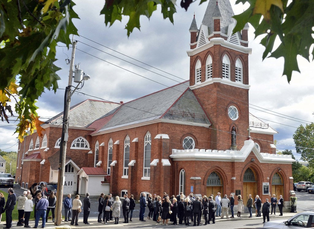 """Mourners enter St. Stanislaus Roman Catholic Church to attend calling hours for Schoharie limo crash victims; Abigail (King) Jackson, Adam """"Action"""" Ja"""