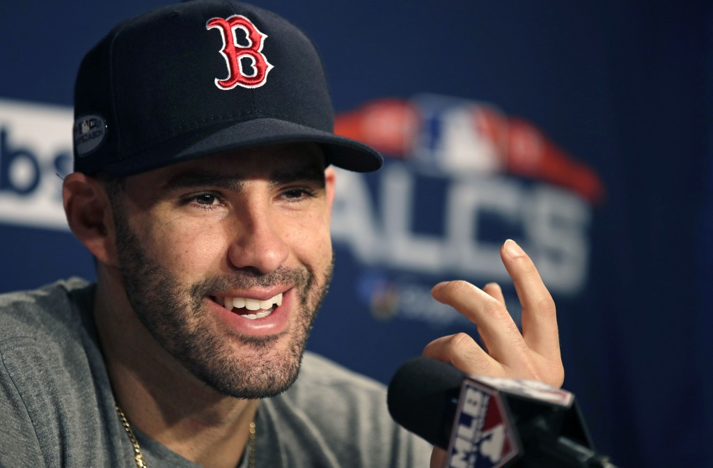 Boston Red Sox right fielder J.D. Martinez gestures as he is interviewed prior to a workout at Fenway Park, Friday, Oct. 12, 2018, in Boston. The Red