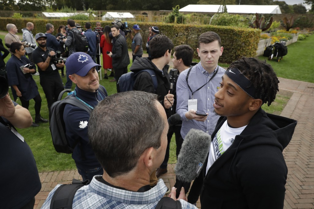 Seattle Seahawks' safety Bradley McDougald speaks in a media huddle after an NFL training session at the Grove Hotel in Chandler's Cross, Watford, Eng