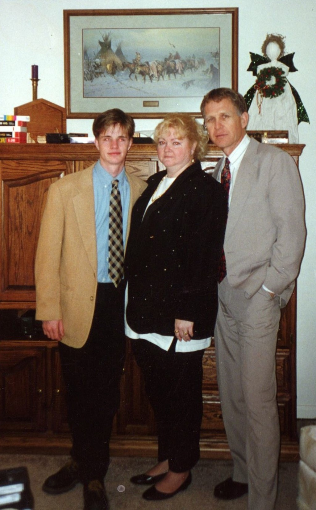 This undated photo provided by the Matthew Shepard Foundation, shows Matthew Shepard, left, with his parents, Judy and Dennis Shepard. The murder of S