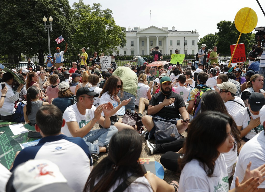 FILE - In this April 29, 2017, file photo, demonstrators sit on the ground along Pennsylvania Ave. in front of the White House in Washington. The Nati