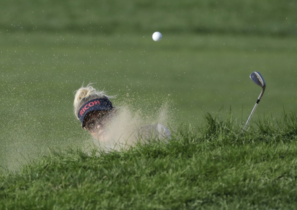 Charley Hull of England hits a shot out of a bunker on the 18th hole during the third round of the LPGA KEB Hana Bank Championship at Sky72 Golf Club
