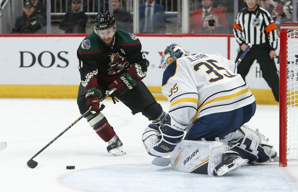 Buffalo Sabres goaltender Linus Ullmark (35) makes a save against Arizona Coyotes center Derek Stepan in the second period during an NHL hockey game,