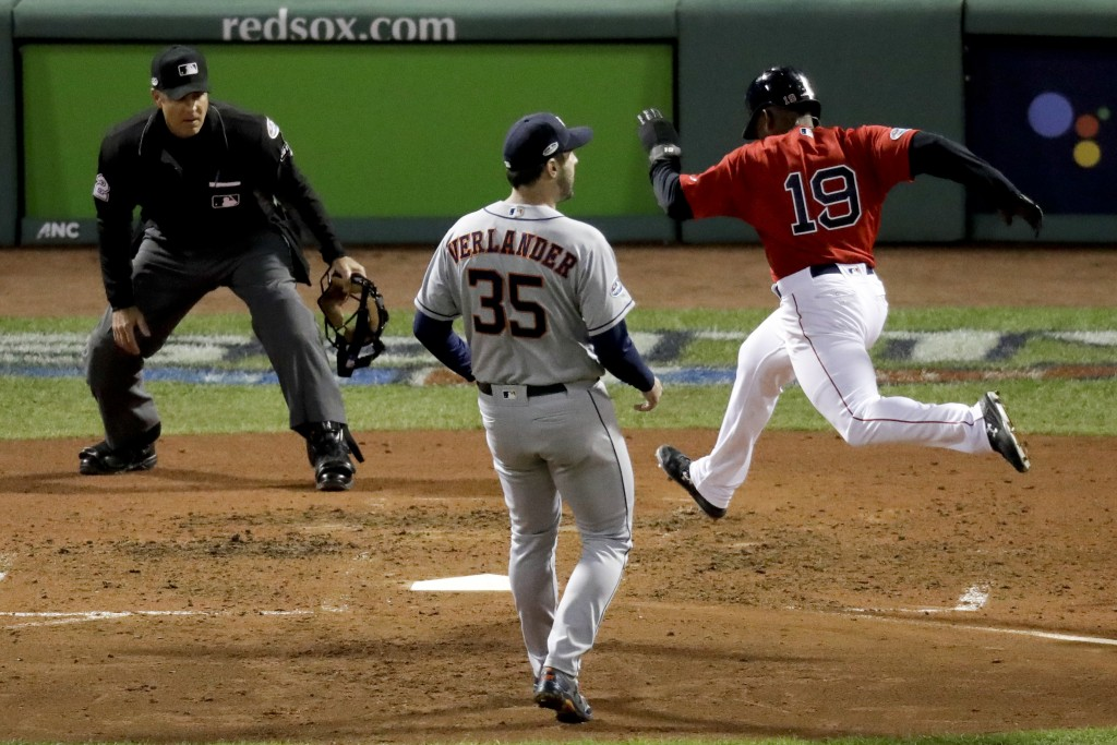 Boston Red Sox's Jackie Bradley Jr., right, scores past Houston Astros starting pitcher Justin Verlander on a wild pitch during the fifth inning in Ga