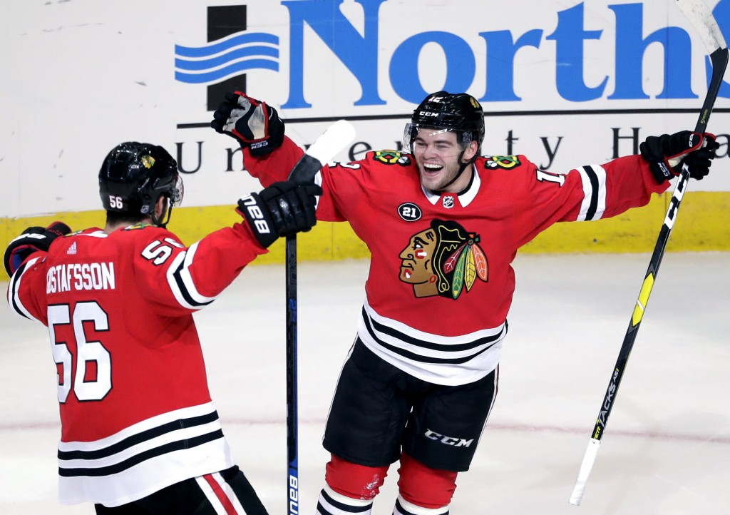 Chicago Blackhawks right wing Alex DeBrincat, right, celebrates with defenseman Erik Gustafsson after scoring against the St. Louis Blues during overt