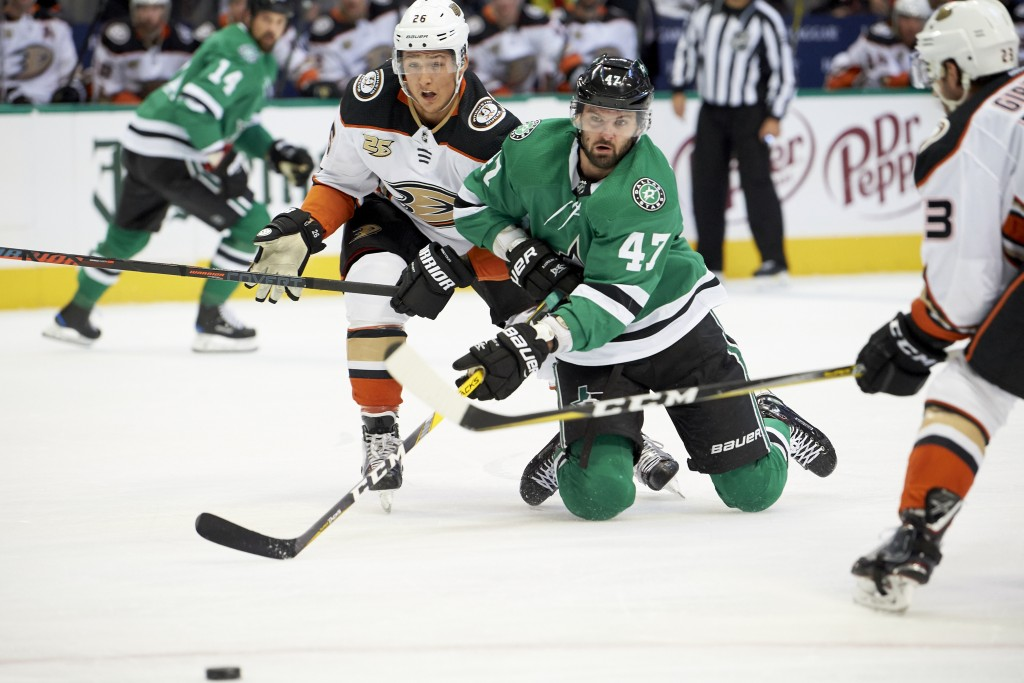 Dallas Stars right wing Alexander Radulov (47), of Russia, battles for the puck with Anaheim Ducks defenseman Brandon Montour (26) during the first pe