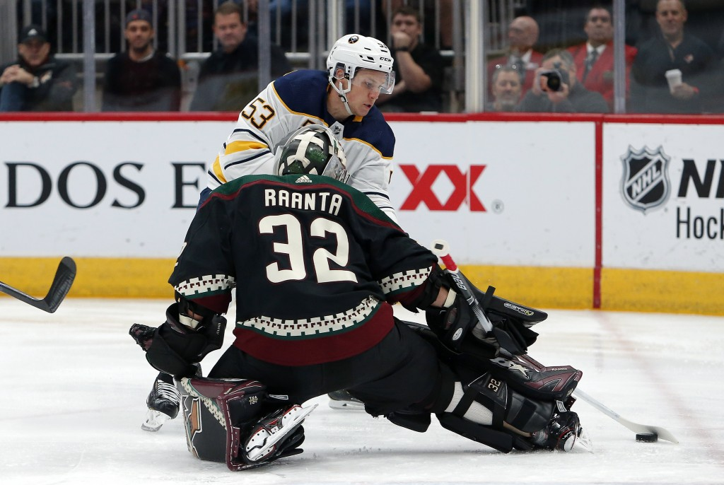 Buffalo Sabres center Jeff Skinner shoots on Arizona Coyotes goaltender Antti Raanta (32) in the first period during an NHL hockey game, Saturday, Oct