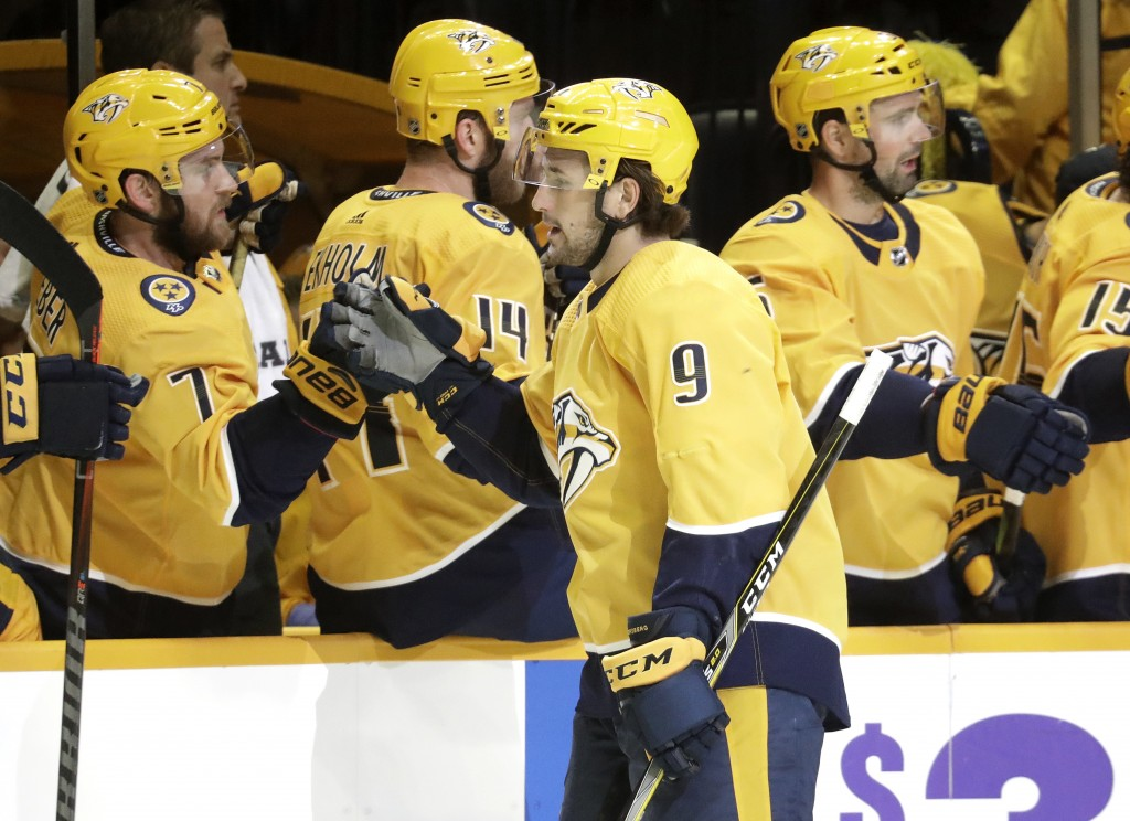 Nashville Predators left wing Filip Forsberg (9), of Sweden, is congratulated after scoring a goal against the New York Islanders during the first per