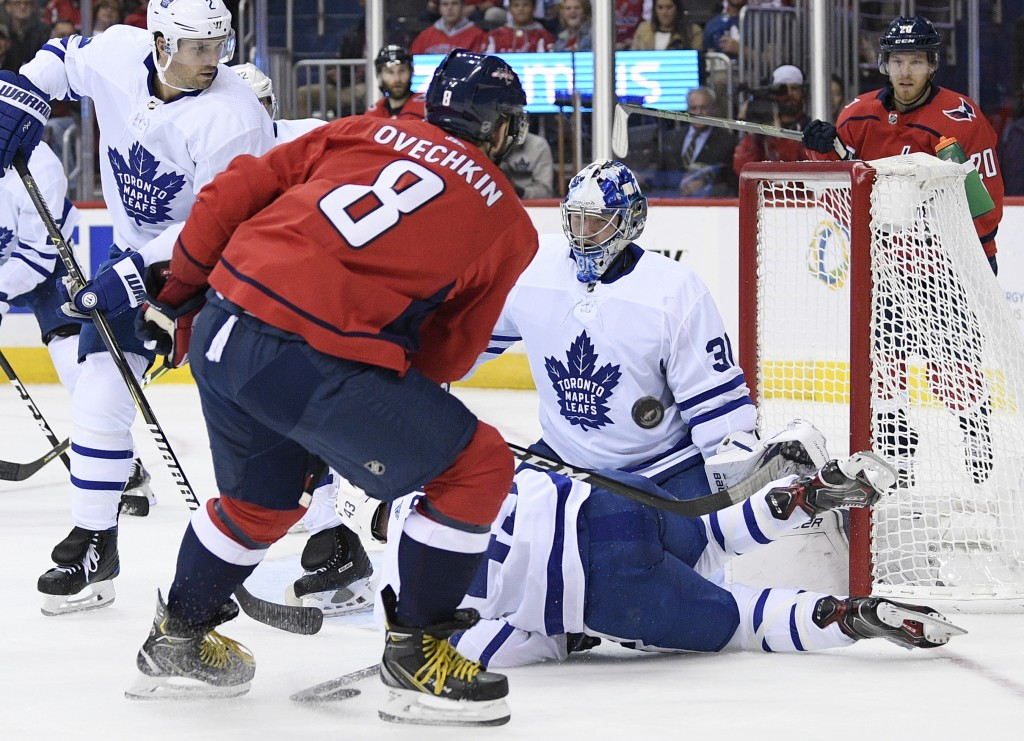 Toronto Maple Leafs goaltender Frederik Andersen (31), of Denmark, stops the puck against Washington Capitals left wing Alex Ovechkin (8), of Russia,