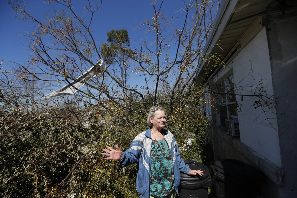In this Oct. 13, 2018 photo, Mary Frances Parrish reacts outside her damaged home, in the aftermath of Hurricane Michael in Panama City, Fla. In the d...