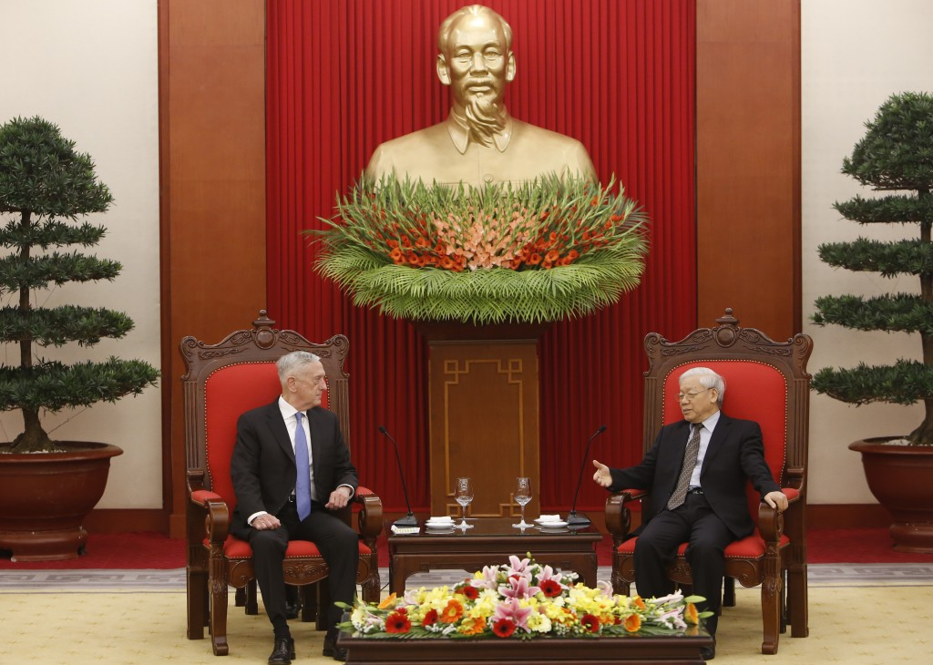 FILE - In this  Jan. 25, 2018, file photo, U.S. Secretary of Defense Jim Mattis, left, listens during talks with Vietnam's Communist Party General Sec...