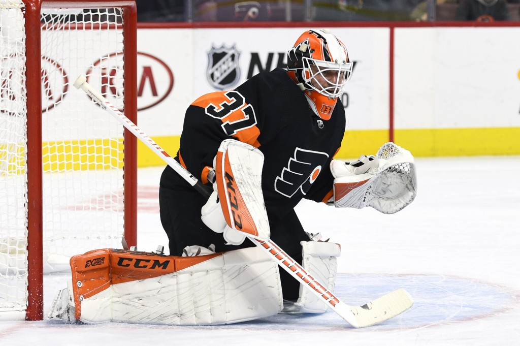 Philadelphia Flyers' goaltender Brian Elliott looks for the puck during the first period of an NHL hockey game against the Vegas Golden Knights, Satur
