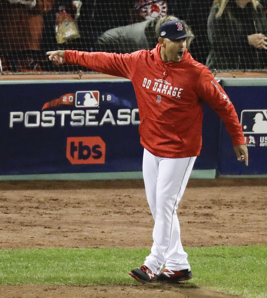 Boston Red Sox manager Alex Cora argues a strike three call during the fifth inning in Game 1 of a baseball American League Championship Series agains