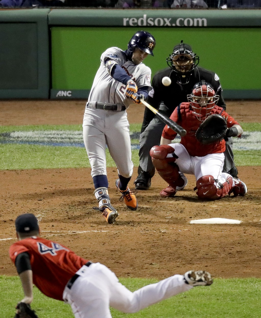 Houston Astros' Josh Reddick hits a home run against the Boston Red Sox during the ninth inning in Game 1 of a baseball American League Championship S