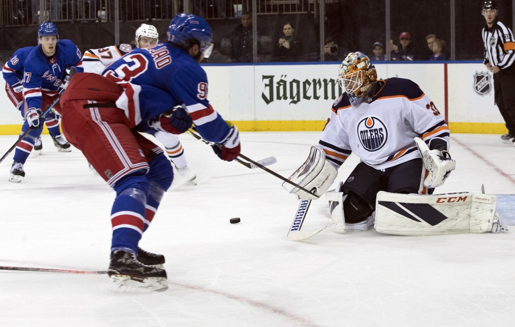 Edmonton Oilers goaltender Cam Talbot (33) makes the save against New York Rangers center Mika Zibanejad (93) during the second period of an NHL hocke