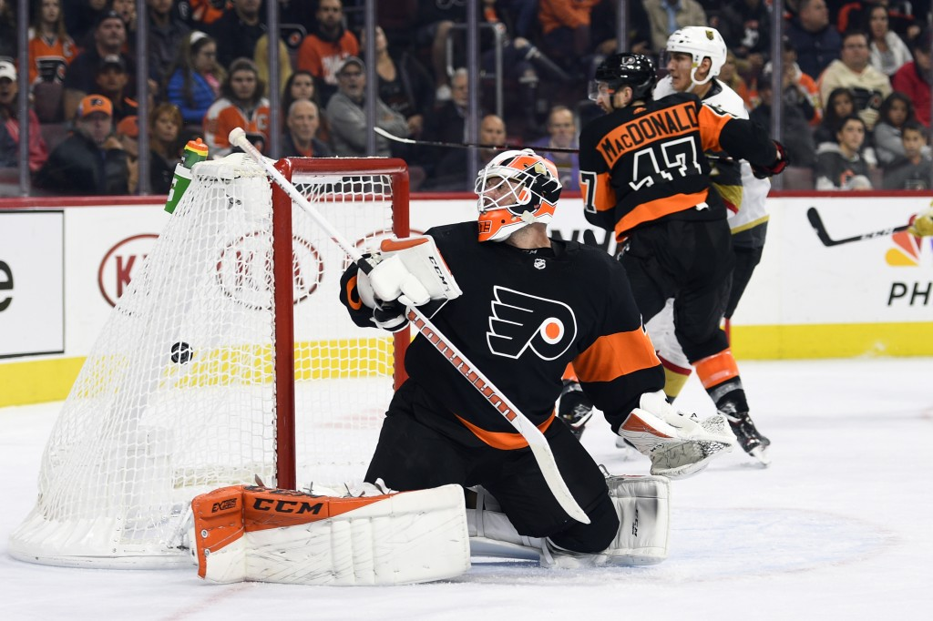 Philadelphia Flyers goaltender Brian Elliott watches the puck after giving up a goal to Vegas Golden Knights' Cody Eakin during the third period of an