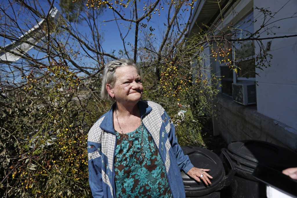 Mary Frances Parrish reacts outside her heavily damaged home, in the aftermath of Hurricane Michael in Panama City, Fla., Saturday, Oct. 13, 2018. She...