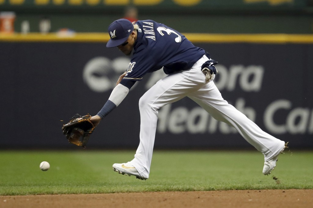 Milwaukee Brewers shortstop Orlando Arcia (3) is unable to reach the ball hit by Los Angeles Dodgers' Joc Pederson during the ninth inning of Game 2 o