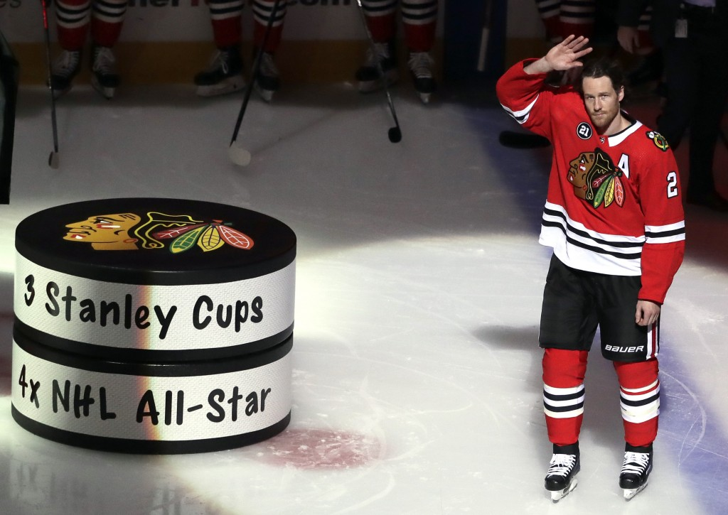 Chicago Blackhawks' Duncan Keith waves to fans during a pregame ceremony honoring for his 1000th game as a Blackhawks player before an NHL hockey game