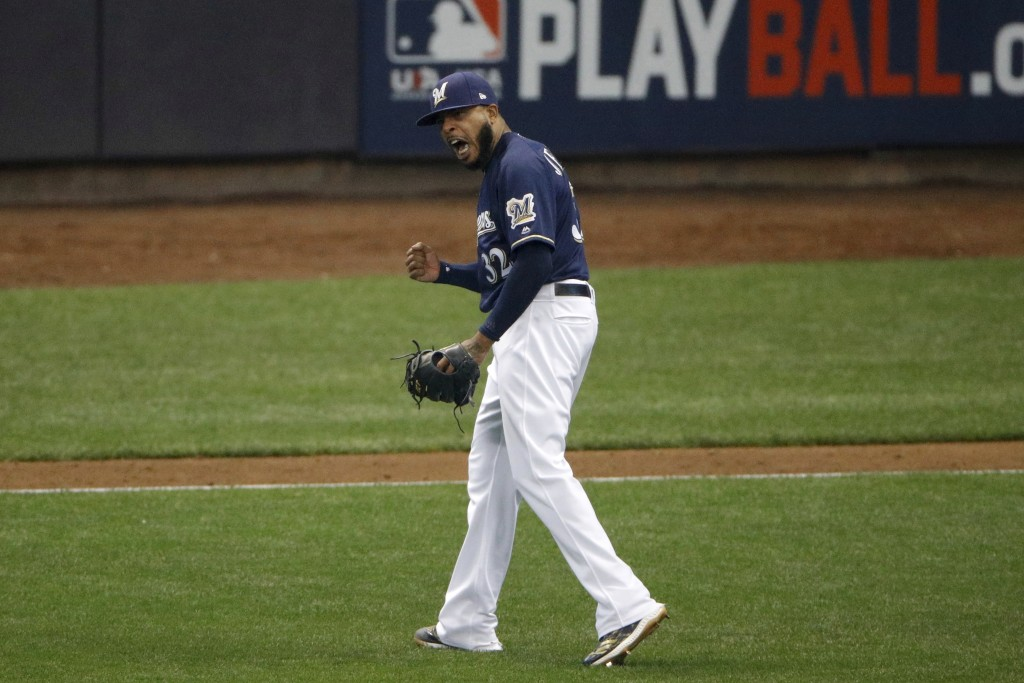 Milwaukee Brewers relief pitcher Jeremy Jeffress (32) reacts after a double play during the seventh inning of Game 2 of the National League Championsh