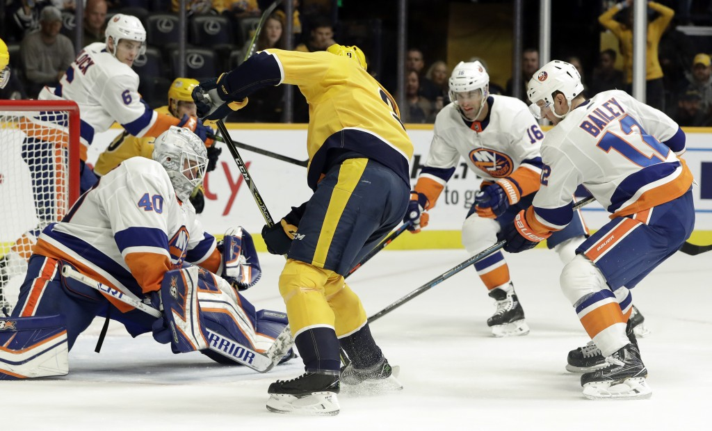 New York Islanders goaltender Robin Lehner (40), of Sweden, blocks a shot by Nashville Predators left wing Filip Forsberg (9), of Sweden, during the s