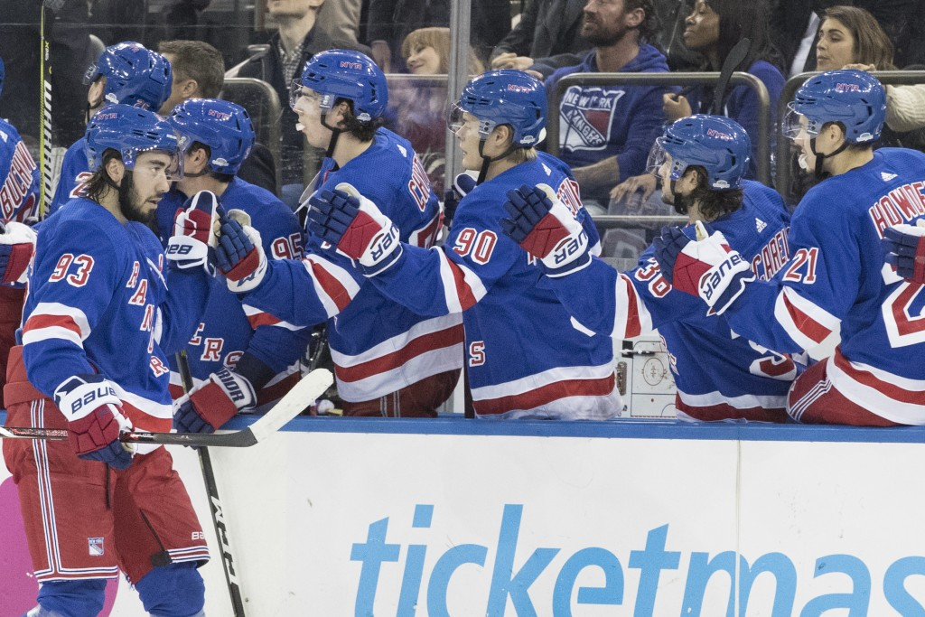 New York Rangers center Mika Zibanejad (93) celebrates scoring a goal with his teammates during the first period of an NHL hockey game against the Edm