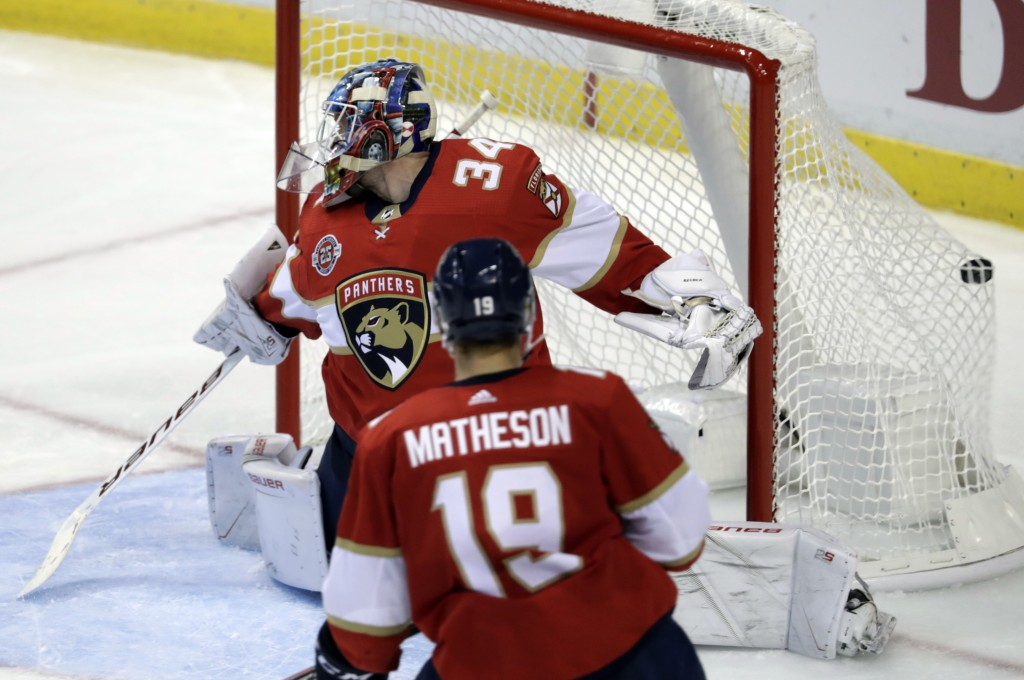 The puck gets past Florida Panthers goaltender James Reimer (34) on a goal scored by Vancouver Canucks center Bo Horvat during the third period of an