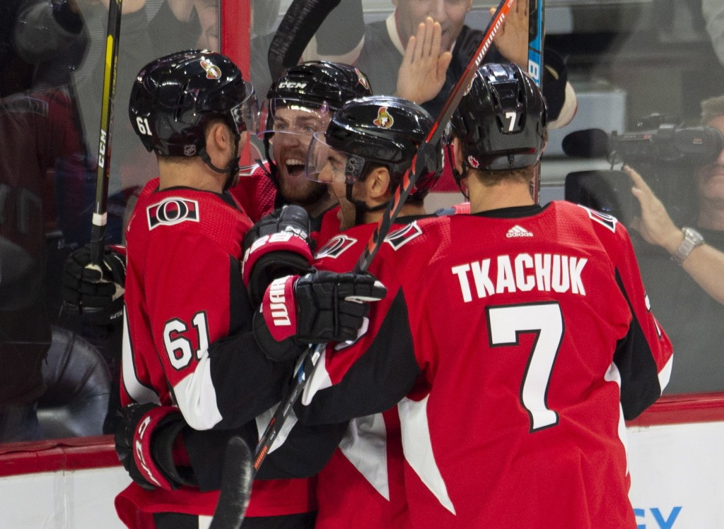 Ottawa Senators centre Chris Tierney, second from left, celebrates his goal with teammates right wing Mark Stone *(61), defenceman Dylan DeMelo (2) an